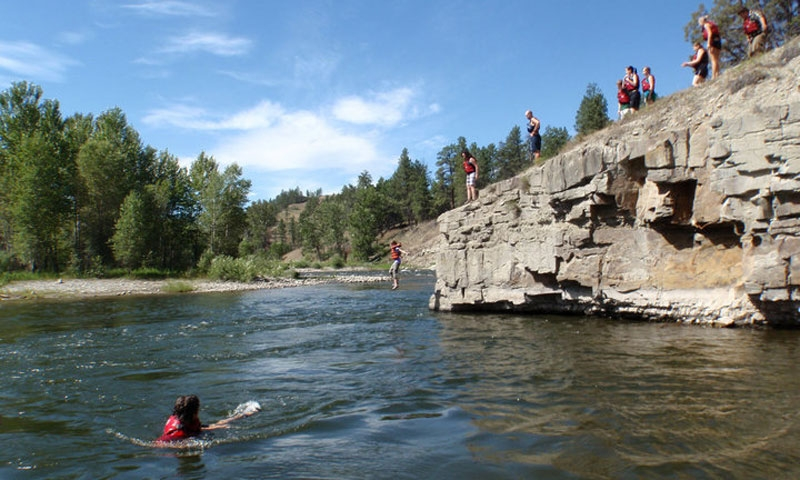 Jumping from a rock during a Whitewater Rafting Adventure